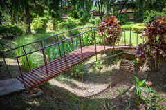 Old bridge in gardens stock photography