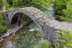 Old bridge in Greece. Old stone bridge in Epirus, Greece Stock Images