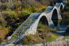 Old bridge in Greece. Traditional stone bridge in Epirus, Greece Royalty Free Stock Images