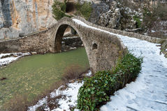 Old bridge in Greece. Traditional stone bridge in Epirus, Greece Royalty Free Stock Image