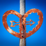 Old bridge heart with an arrow sculpture landmark Royalty Free Stock Photo