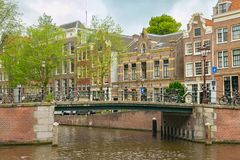 Old bridge in the historical center of Amsterdam. Old bridge in the historical center of Amsterdam, Netherlands royalty free stock image