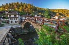 Old bridge. And houses in Shiroka Laka, Bulgaria Stock Photo