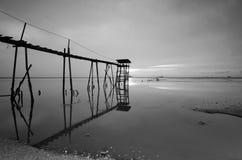 Old bridge at jeram beach in black and white mode. Royalty Free Stock Image