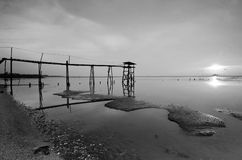 Old bridge at jeram beach in black and white mode. Stock Photos