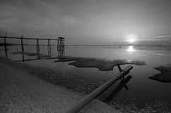 Old bridge at jeram beach in black and white mode. Royalty Free Stock Photography