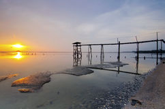 Old bridge at jeram beach during sunset Royalty Free Stock Photography