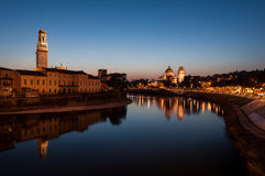 From the old bridge. Long exposure photos of Verona, taken on the stone bridge crosses the Adige River, the scene of the Adige, the bell tower of the Duomo of Royalty Free Stock Photography