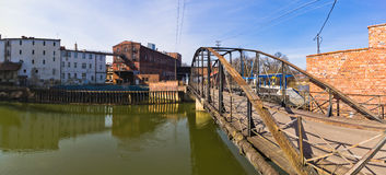 Old bridge and mill in Brzeg, Poland. Old bridge and automatic mill in Brzeg, Poland Royalty Free Stock Images