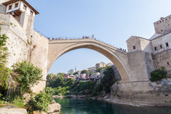 Old bridge, Mostar. MOSTAR, BOSNIA - AUGUST 10: Man ready to jump from old bridge on August 10, 2012 in Mostar, Bosnia. It is a tradition for men to dive off the Royalty Free Stock Photography