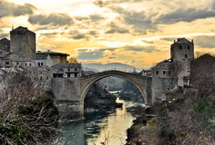 Old Bridge in Mostar. Photograph of an old bridge with a yellow sunrise Royalty Free Stock Photo