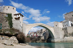 Old Bridge in Mostar. Bosnia and Herzegovina with the old town and blue sky in background Stock Image