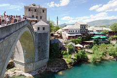 Old Bridge, Mostar. MOSTAR, BOSNIA AND HERZEGOVINA - MAY 18, 2013: Man ready to jump from old bridge on August 10, 2012 in Mostar, Bosnia. It is a tradition for Royalty Free Stock Image
