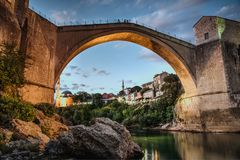 Old bridge in Mostar in Bosnia and Herzegovina. A pedestrian arch bridge across the Neretva River in Mostar, Bosnia and Herzegovina Royalty Free Stock Images