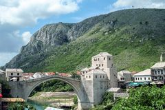Old Bridge of Mostar during a sunny afternoon. This bridge is the symbol of the war torn main city of Herzegovina Stock Images