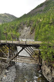The old bridge in the mountains. Royalty Free Stock Image