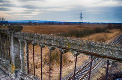 Old bridge near forest and close to the railway Royalty Free Stock Images