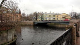 Old bridge and old houses on the river Moika. Fall, St. Petersburg, Russia stock video footage