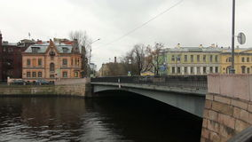 Old bridge and old houses on the river Moika. Fall, St. Petersburg, Russia stock footage