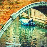 Old bridge over canal in Venice,. Old small arch bridge over canal in Venice, Italy. Retro style Royalty Free Stock Photo