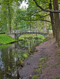Old bridge over flow in the palace park in Gatchina Stock Photos