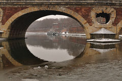 Old bridge over frozen river in Toulouse. France Royalty Free Stock Image