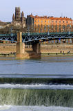 Old bridge over Garonne Stock Photos