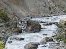 Old bridge over Marsyangdi river valley Stock Photo