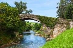 Old bridge over Miera river Stock Photo