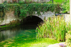 Old bridge over river Coln in village Bibury England Stock Photography