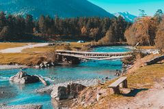 Old bridge over the river in the countryside. Travel landscape duckweed ancient sunset grass wood creek remote summer sunlight flowing walk nobody colorful stock photography