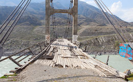 Old bridge over the river Katun, Altai, Russia. Royalty Free Stock Photo