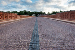 Old bridge over the river with pavement. royalty free stock photo