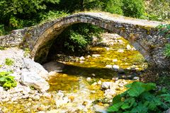 Old bridge over the river in the Rhodopes, Bulgaria Royalty Free Stock Image