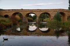 Old bridge over a river. Old bridge in Richmond, Tasmania, oldest bridge in Australia still in use Stock Images