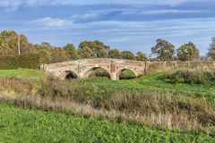 Old bridge over Rother river. On a sunny autumn day with green grass and blue sky Royalty Free Stock Photography