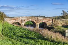 Old bridge over Rother river. On a sunny autumn day with green grass and blue sky Stock Photography