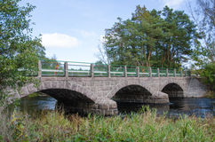 Old bridge over a small river Royalty Free Stock Photo