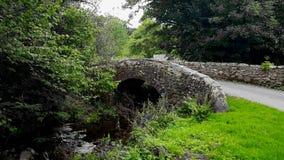 Old bridge over a stream on dartmoor national park Devon uk. Old bridge over a stream on DartmoorNationalPark devon uk royalty free stock photography