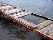 Old Bridge over the water 2. Old and deteriorated bridge used to cross over the water Royalty Free Stock Photos