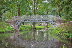 Old bridge over water in the palace park in Gatchina Royalty Free Stock Photo