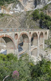 Old bridge of quarry marble in Italy Stock Photos