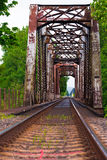 The old bridge and railroad tracks stock photography