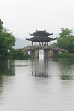 Old bridge and rain of chinese west lake Royalty Free Stock Photo