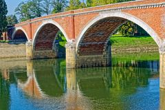 Sisak old bridge. Old bridge on river Kupa on a beautiful sunny day in Sisak Croatia Royalty Free Stock Images