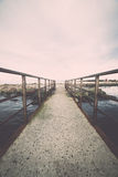 Old bridge with rusty metal rails Royalty Free Stock Image