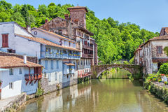 Old bridge in Saint-Jean-Pied-de-Port. Arch bridge over the river La Nive de Beherobie in small town Saint-Jean-Pied-de-Port, Aquitaine, France Stock Images