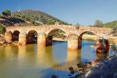 Old bridge in San Rafael on the Odiel river, Spain Stock Photo