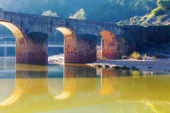 Old bridge in San Rafael on the Odiel river, Spain Royalty Free Stock Images