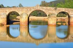 Old bridge in San Rafael on the Odiel river, Spain Royalty Free Stock Photos